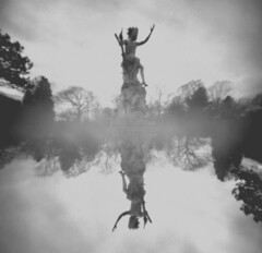 Unreflected Peter Pan (vinkev) Tags: rose statue garden peterpan pinhole botanicalgardens sheffieldbotanicalgardens