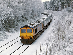 Tankers in the Snow (Gerry Balding) Tags: winter england snow train diesel norfolk freight eastanglia tankers class66 thorpestandrew gbrailfreight redlightning 66702 dussindale thebitternline