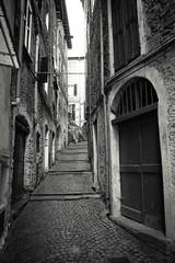 Dolceacqua (Cthulhu79) Tags: old blackandwhite bw italy white black stone architecture canon italia shadows medieval shade tamron alleys xsi dolceacqua 450d