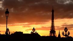 Eiffel tower from Port Neuf (Harish-Rao) Tags: sunset orange paris lamp eiffeltower portneuf