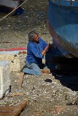 more fiberglass (cam17) Tags: southamerica chile chiloe islachiloe boatyard boatrepair boatbuilding fiberglass fisherman beachdrydock boatstern townofdalcahue waterfronttown