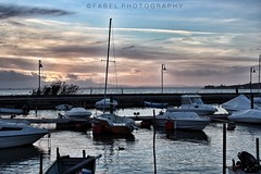 the port of San Feliciano at sunset (fabriziobelia) Tags: italy boats umbria canon trasimeno lake sunset