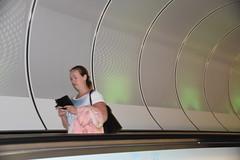 Lonesome traveller (myphotomailbox) Tags: rotterdam netherlands metro wilhelminaplein girl underground pink phone tunnel glitter