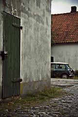 Backyard (niklashofe) Tags: door old roof grass barn canon germany eos town backyard afternoon hamburg stormy mini cobblestone rainy beatup niedersachsen buchholz 60d