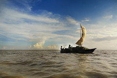 Trade Wind (Md. Rasedul Islam) Tags: life sky nature beautiful river boat ngc wave sail bangladesh ghat padma maowa