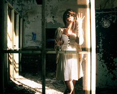 Mad in the mind. (Daniella Alvarez) Tags: portrait sunlight selfportrait abandoned girl architecture female fence dress decay postoffice indiana gary safe sidelight