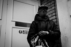 (Matt Obrey) Tags: street boy blackandwhite black monochrome hat birmingham hand mask streetphotography x100 birminghamstreet fujix100