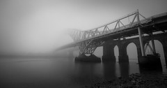 Bridge Mist (lemonshed) Tags: road morning bridge autumn sea blackandwhite bw mist fog canon river am cheshire sunday transport sigma rail getty 1020mm mersey 2012 runcorn merseyside widnes 600d gettycurator