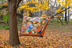 Out of This World quilt (Sewfrench) Tags: blue orange brown green fall colors yellow modern quilt scrappy scrapquilt drunkardspath handquilted scrapbuster bloggersquiltfestivalquilt