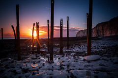 (drfugo) Tags: sunset england sky cloud seaweed beach rock star sussex chalk iron shingle explore pebble worldwarii flare barbedwire newhaven whitecliffs defences strut explored sigma28mmf18exdg canon5dmkii iaintgoingtoyourstreamifyoujustsaygratsonexplored
