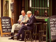 Keeping up appearances (maistora) Tags: life street old city uk two portrait england men london businessman shopping prime pub shoes fuji hole serious zoom britain quality candid duo politics tie impoverished class dressedup wear 300mm