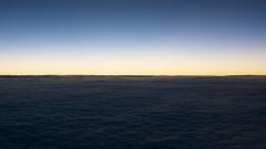 Horizon (OzGFK) Tags: blue sunset sky clouds airplane flying korea aeroplane seoul bluehour asiana windowseat