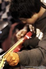 Making Music (Abhranil Das) Tags: music 50mm bokeh guitar tuning
