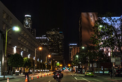 In the Middle of the Street (Panas Photography) Tags: city urban abstract trafficlight cop downtownla movieset lifeinthecity motocycle citylight traillight theeasternbuilding