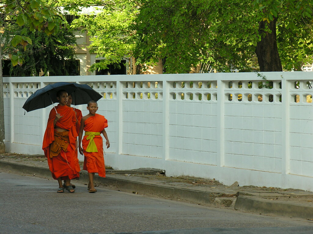 Monks strolling in Mukdahan, Northeast Thailand