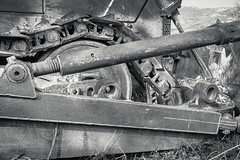 Abandoned Caterpillar (Nicolas P. Tschopp) Tags: bw tractor abandoned broken nature landscape blackwhite rust track offroad britain steel wheels band engine rusty cyprus equipment caterpillar pollution gb vehicle environment motor rough waste rotten discarded trademark tread useless manufactured spareparts dumped careless
