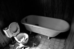 Bathroom in Abandoned House (photographyguy) Tags: abandoned oklahoma bathroom toilet commode picher clawfootbathtub