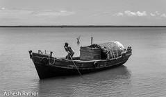 Hukitola (asheshr) Tags: hukitola blackandwhite blacknwhite monochrome mono boat boatman boatride orissa odisha