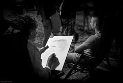 cartoon in 5 minutes ( joaquim nunes) Tags: monocromtico blackwhite preto e branco pessoas mar ocean arte bw fair medievalfair gente profundidade de campo msico artista fundo leicam8 summicronm35mm