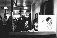 Street food (Nico Ferrara) Tags: streetphotography blackandwhite london soho japanese food shot people juxtaposition bw biancoenero