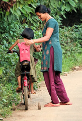 Her First Bike (sphaisell) Tags: india munnar kerala bike bicycle woman child girl people childhood village mother daughter