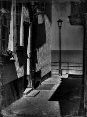 The lampost at the end of the lane. (Steve.T.) Tags: blackandwhite bnw lane cromer norfolk lampost victorian gaslight buildings architecture shadows sea nikon d7200 perspective