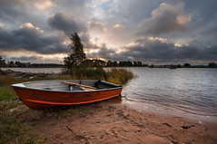 Beach safety (- David Olsson -) Tags: skutberget karlstad sweden vrmland lake vnern water trees reed windy beach sand grass boat rowboat rescueboat orange oars dramaticsky cloudy clouds morning early sunrise dawn landscape lakescape 2exposures manualblend manuallyblended nikon d5000 tripod sigma 1020 1020mm dx davidolsson colour october 2012 fall hst autumn livbt safety scenicsnotjustlandscapes