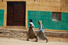 Girls walking in the street - Hawzien village, Tigray, Ethiopia (Alex_Saurel) Tags: africa street city trip travel people woman house girl wall architecture female village femme culture pedestrian ethiopia abyssinian maison rue mur fille personnes ville colorwall afrique etiopia abyssinia ethiopie abyssinie abisinia etiopija habesistan maisontraditionnelle  etiopien  abissinia  abessinien etiyopya  traditionnalhouse    pieton    dt35mmf18sam athiopien ethiopie etiopia etiopia