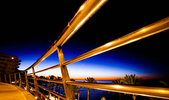 Dawn (Steve-h) Tags: architecture fence nightshot gold golden curve lights rooftop apartments path palms shoppingcomplex sunrise dawn longexposure 30secondexposure 30seconds velbontripod velbon tripod gigatproii wirelessremotecontrolshutterrelease marbella costadelsol andalucia andalusia spain holiday vacation resort december2012 winter2012 december winter 2012 cann wideangle zoom eos canonef1635mmf28liiusm canoneos5dmk2 canoneos5dmkii steveh allrightsreserved aerlingus europe art design tourism tourists recreation beach seashore seaside sand infinitexposure europa eu nature natur natura naturaleza 21818v 798f