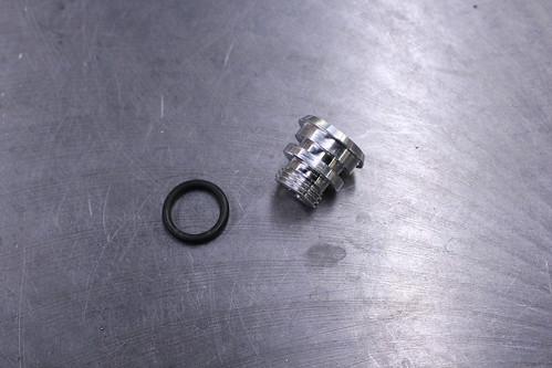 stem cap machined w/rubber washer