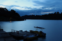 Silent Message (rogelio g arcangel) Tags: lighting blue sunset sky urban silhouette clouds lights twilight singapore asia quiet sundown bluesky serenity bluehour stillness stormclouds rainclouds macritchie macritchiereservoir reservoirs settingstorm