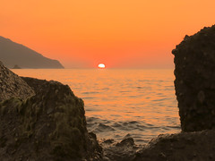 Going Under (Andrea Merenda) Tags: sunset sea italy cliff costa mountain coast italia tramonto mare patti sicily montagna sicilia messina mediterraneansea scogli scoglio tirreno marmediterraneo martirreno mongiove golfodipatti canonpowershotsx40hs scogliodipatti pietrainmezzoalmaree