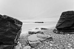 Stuck between a Rock and Hard Place (russellcram) Tags: sea bw white black sunrise coast big nikon rocks long sigma le lee 1020mm beech stopper expsoure 10stop d7000