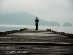 Distance (RJOYPhotography) Tags: wood boy people lake man water docks person blurry dock focus harrison bokeh lakes panasonic harrisonlake floatingdock blinkagain rjoyphotography