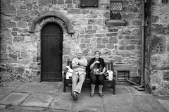 Historic Picnic (nigelhunter) Tags: historic picnic kirkby lonsdale cumbria candid street couple bench door wall church stone