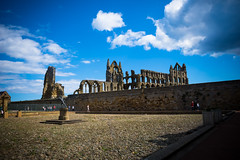 behind the wall (pamelaadam) Tags: geo:lat=54488344 whitby whitbyabbey engerlandshire august summer 2016 holiday2016 building abbey kirk faith spirituality digital fotolog thebiggestgroup people lurkation geolon0607894