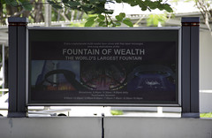 The signboard of the Fountain of Wealth in Suntec City (Ashish A) Tags: trees tree tourism fountain sign metal circle asian singapore asia tourist structure suntec signboard touristattraction circular treebranch sunteccity fountainofwealth metalring suntecmall sunteccenter