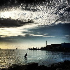 Enter Galveston Bay (Mabry Campbell) Tags: instagramapp water coast coastal sunrise morning square squareformat iphoneography uploaded:by=instagram lofi foursquare:venue=4cde925effcf370483641382 surfside texas photo photograph photography 2012 november usa us unitedstates mabrycampbell iphone october kemah tx newmexico