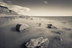 Seascape (Berren Photography) Tags: blue sunset sea portrait cliff white seascape black water yellow rock canon landscape photography amazing long exposure slow smooth 24 mm scape rees 1022 550d berren