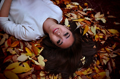 Living Day by Day (Lynnea.tan) Tags: blur fall smile leaves sweater shadows pavement warmtones riskypositions