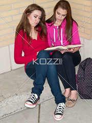 friends studying together (elisapeople2012) Tags: friends girl beautiful beauty modern female bag reading book togetherness concentration student education pretty sitting friendship fulllength teenagers highschool learning companion studying twopeople casualwear preparations bonding teamwork caucasian schoolbag companionship youthculture casualclothing universitystudent 1617years teenagersonly legscrossedatknee onlygirls personineducation teenagegirlsonly
