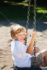 side view of a smiling boy sitting on tire swing (oprahpeople2012) Tags: park boy shadow portrait cute male grass childhood smiling fun outdoors happy photography sand holding day sitting child joy fulllength adorable lifestyle happiness sunny swing chain innocence daytime freetime playful carefree enjoyment tyre gripping caucasian sparetime toothysmile casualclothing colorimage lookingatcamera leisureactivity tyreswing oneboyonly 67years elementaryage