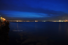 Strait of Gibraltar by Night (andrewtijou) Tags: light sea night reflections spain nikon nightshot nighttime straitsofgibraltar lalineadelaconcepcion d5000 andrewtijou