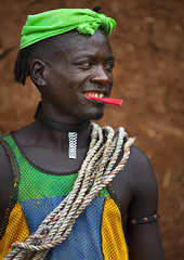 Mr Rolo, Bana Tribe Man, Key Afer, Omo Valley, Ethiopia (Eric Lafforgue) Tags: africa portrait people man color smile basketball vertical outside photography necklace colorful day outdoor culture jewelry tribal ornament adobe string omovalley tradition ethiopia tribe pastoral ethnic bizarre bana hamar bodymodification oneperson jewel hamer onepeople confidence headwear hornofafrica ethnology omo banna eastafrica oneman tribesman onepersononly realpeople colorimage lookingatcamera beautify benna onemanonly waistup 9967 keyafer africanethnicity pastoralist pastoralism snnpr bodytransformation watchbracelet oneadult oneadultonly southernnationsnationalitiesandpeoplesregion hamerbenaworeda ethiopianethnicity hamerbena hammerbena eth9967