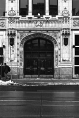 Toronto - New Year's Eve (.:Axle:.) Tags: city urban bw toronto streets slr film 35mm buildings blackwhite nikon downtown random police 135 nikonf4 filmphotography homedeveloped bluefire iso80 12minutes afnikkor50mm114d bluefirepolice believeinfilm bluefirehrdeveloper