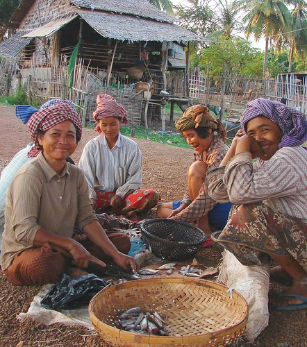 Women processing fish in Cambodia. Photo by Adelia Ribier, 2007.