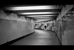 Far From Gone (Justin Wolfe) Tags: city light portrait urban blackandwhite bw cinema man cold reflection classic film philadelphia monochrome station silhouette stairs contrast train 35mm vintage dark underground subway concrete person lights hall downtown alone centercity cityhall widescreen bare empty sub under neglected grain rangefinder monotone eerie dirty minimal hallway pa forgotten transportation figure isolation philly grainy ilfordhp5plus400 septa passage cinematic argusc3 concourse argus 215 urbex escalate justinwolfe jwolfe