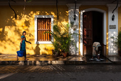 Shadows, Pondicherry (Marji Lang) Tags: life street morning travel light shadow people india house color home beautiful yellow composition contrast jaune work french bucket lightandshadows women day shadows lumire indian working streetphotography atmosphere streetlife scene ombre amarillo dailylife elegant rue kollam tamil tamilnadu femmes pondicherry ordinary elegance streetshot pondy pondi indianwomen travelphotography darkandlight pondichry viequotidienne frenchcolony ef247028l indiansubcontinent puducherry  canoneos5dmarkii quartierfranais bhrat frencharea travelanddocumentaryphotography  marjilang beautyofeveryday