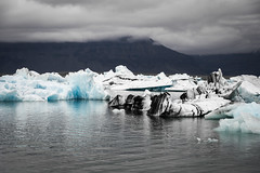 Jkulsrln 06 (arsamie) Tags: iceland jokulsarlon lagoon blue ice iceberg cold snow white black volcano hotspring water state solid liquid north weather cloudy