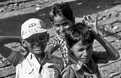 Three Indian Musketeers, b/w (gerard eder) Tags: children boys india calcutta world asia southasia happy naughty laughing kids kinder street streetlife kolkata